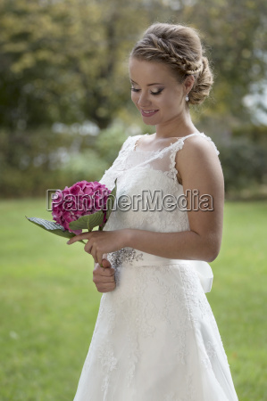 bride with flowers in the garden