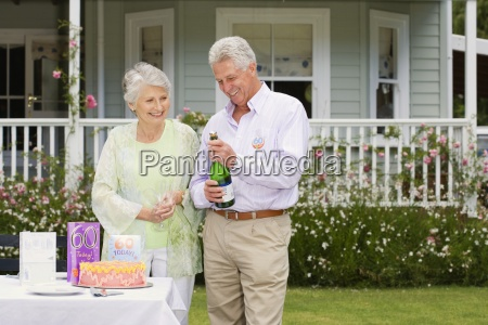 senior couple celebrating xe2x20acx2dc60thxe2x20acx2122 birthday in