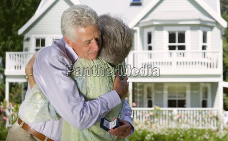 senior couple embracing in summer garden