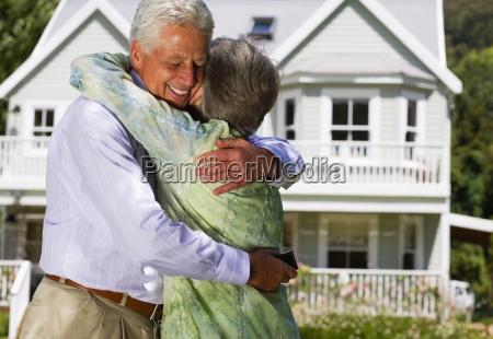 senior couple embracing in summer garden
