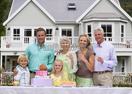 three generation family celebrating birthday in