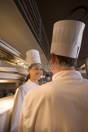 male and female chefs standing at