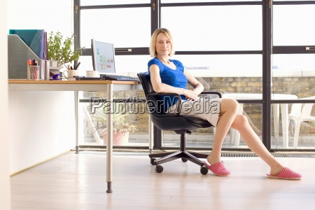 woman sitting by desk and window