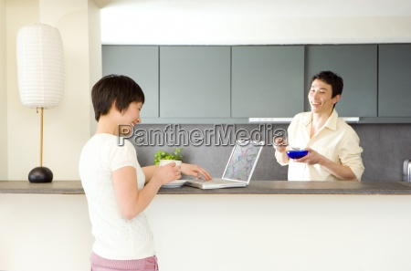 young man with cereal bowl in