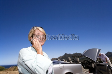 senior woman using mobile phone outdoors