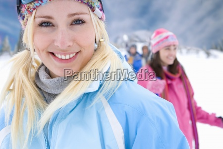 young woman in snow field wearing
