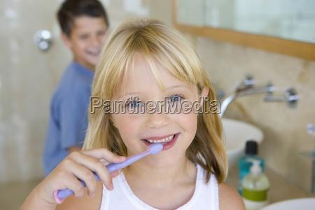 boy and girl 6 8 brushing