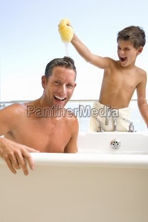 father and son in bathroom son