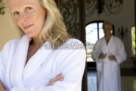 mature couple wearing white bath robes