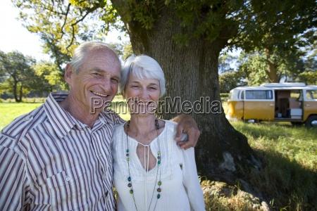 senior couple arm in arm in