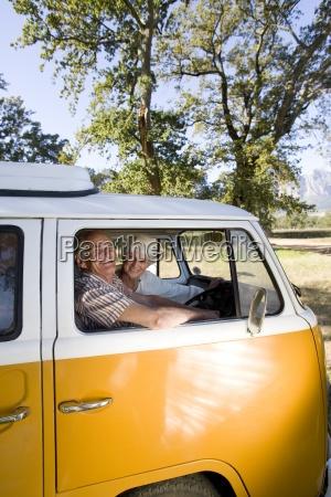 senior couple in camper van smiling