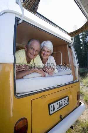senior couple lying in back of