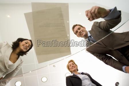 businessman by two businesswomen preparing to
