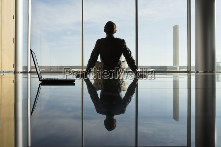 reflection of businessman sitting on floor