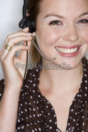 young businesswoman wearing telephone headset smiling