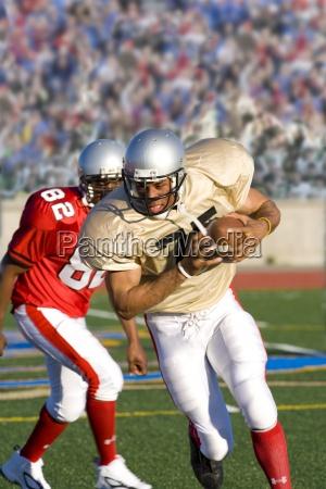 running back running with football