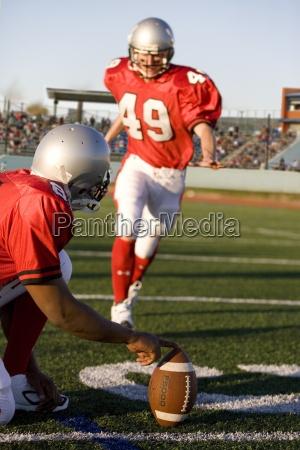kicker kicking football