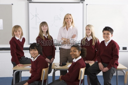 proud teacher and students posing in