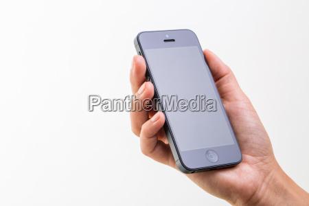 weibliche hand mit einem smartphone isoliert