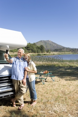 mature couple by lake and motor