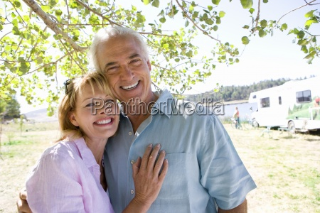 mature couple arm in arm by