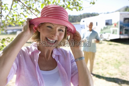 mature woman with hat by husband