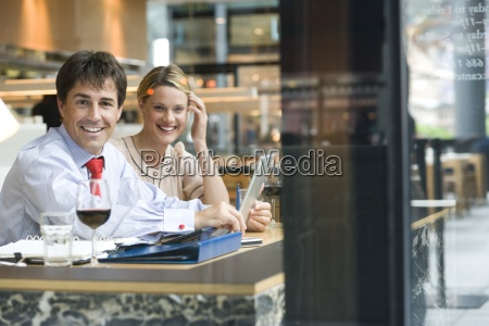 businessman and woman having drink in