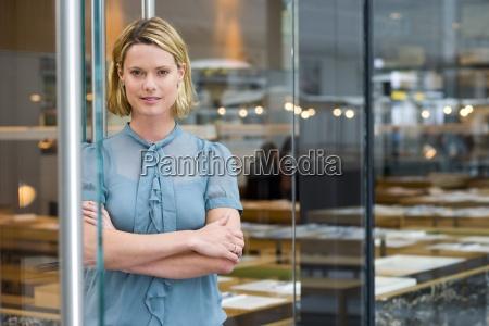 portrait of woman by door of