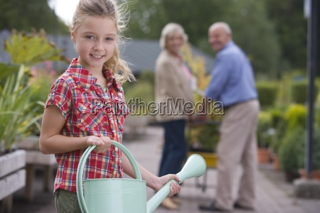 girl 8 10 with watering can