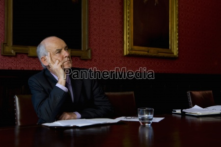 businessman with paperwork in meeting at