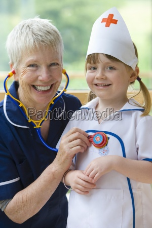 smiling grandmother playing doctor and nurse