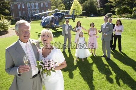 senior couple celebrating marriage outside country