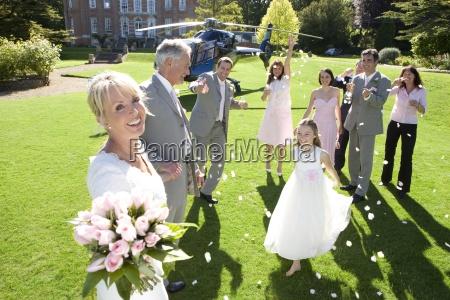 wedding party throwing confetti on senior