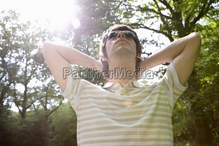 young man relaxing with sunglasses in