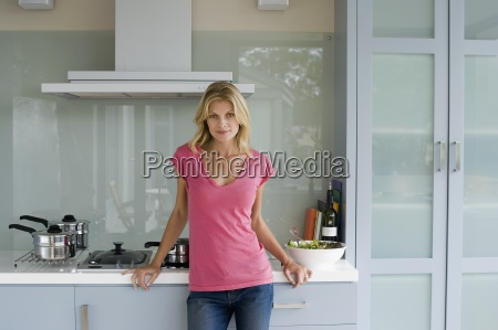 woman in pink top standing in