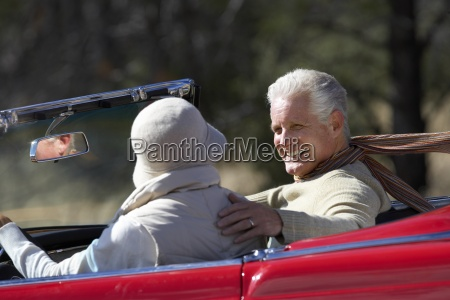 senior couple driving along country road
