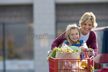 mother and daughter 7 9 pushing
