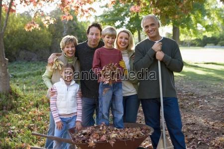 multi generational family standing in garden