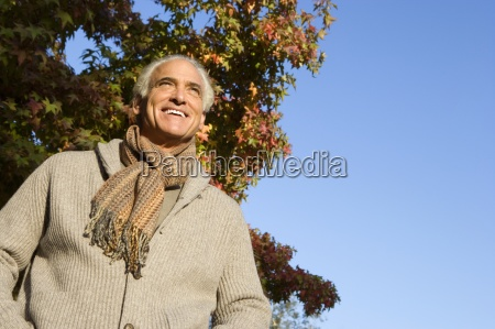 senior man in scarf and hooded