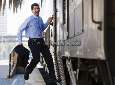 late businessman hurrying to catch passenger