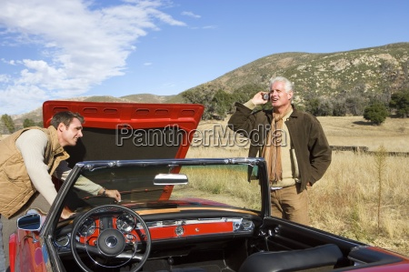 father and son experiencing car trouble