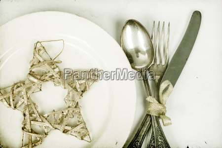 silver table utensils and christmas star