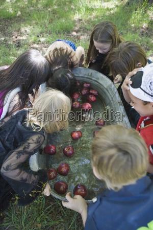 kneeling costume apple biting childhood american