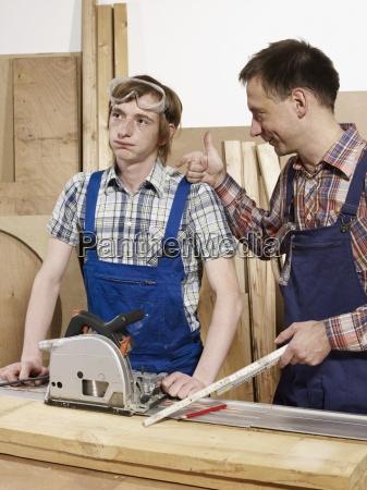 vertical waist up workshop standing wood