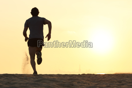 back view silhouette of a runner