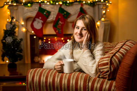 cute smiling woman holding cup of
