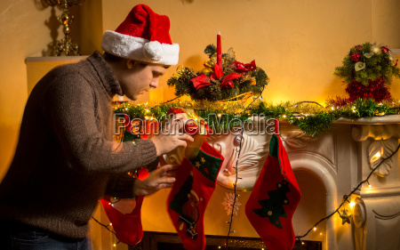 young father putting gifts in christmas