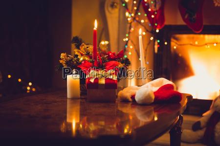 toned photo of burning candles fireplace