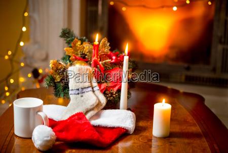 candles woolen socks and santa hat
