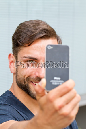 young man doing a selfie